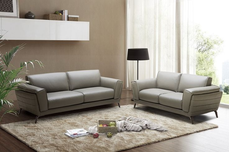 """Berlin Sofa Set SKU18143 for $3328 Description :  J&M is proud to present the  Berlin Sofa Set.  This  exquisite  sofa set  was designed for those that yearn for comfort, luxury, & style. Gorgeouslyupholstered in  Grey Italian Leather & features  spacious seating for maximum comfort.  Materials: Berlin Sofa Set Collection Grey Italian Leather & features  Maximum comfort Free Shipping Dimensions :  Sofa:84""""L x 36""""D x 33""""H Love:68.5""""L x 36""""D x 33""""H"""