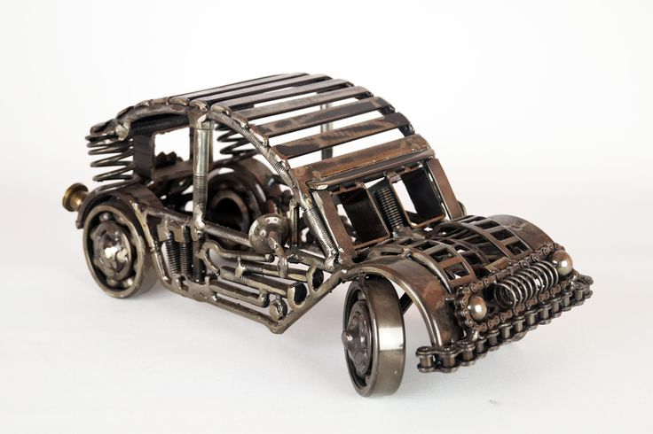 Automobile, Unique artwork made by artist Yiannis Dendrinos, Welded metallic parts, Anti-rust varnished for indoor use, Dimensions 30 x 20 x 20 cm