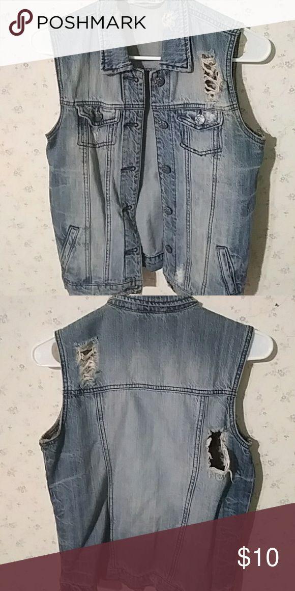 Grunge sleeveless denim jacket Light wash denim jacket with front/side pockets and distressing/tears Vanilla Star Tops