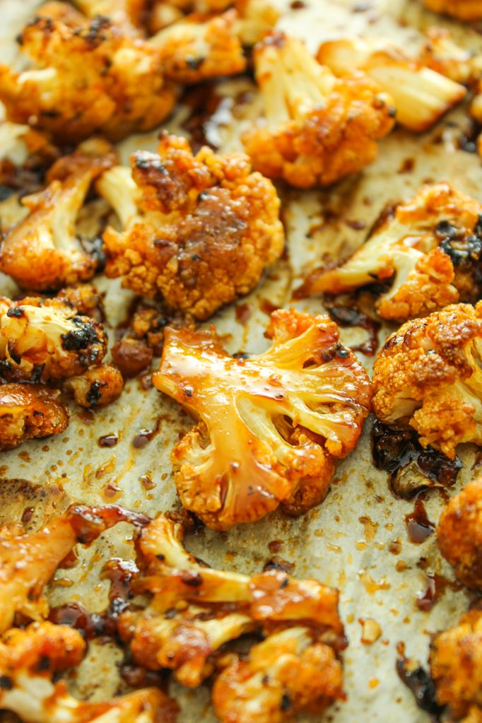 BEST roasted cauliflower recipe. Tossed in an easy sweet and spicy marinade and baked for 30 min. So good!