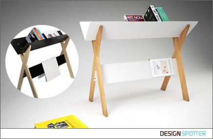 An interesting reading table. A different way to display or store books. I love the bottom ledge that acts as a bookmark