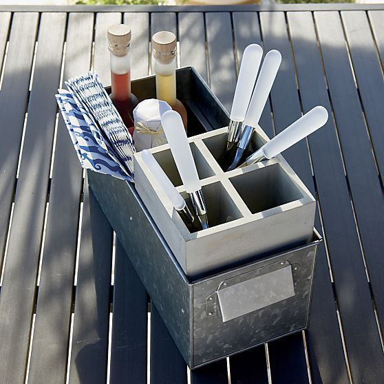 Rustic chic galvanized caddy adds found-object interest while providing deep storage to hold all of your flatware, condiments and napkins. Wooden tray has four divided compartments for easy organization.