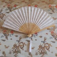 Fan: European Style - White Lace and Bamboo.  The folding fan as we know it today originated in China and Japan 3000 years ago and were picked up by traders to sell to European countries. The Chinese and Japanese cultures created art forms with the fan; dance, opera, ceremonies, social occasions and the classical Geisha made the fan an importance status item.  Bamboo and lace, made in China.  Height 23cm – width 38cm. $13.00au