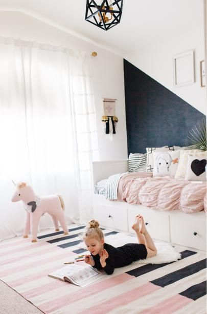 "Elle was so excited to help design her ""big girl"" room. The one criterion was that it had to have a lot of pink. Mission accomplished! I even found a pink unicorn. PC @rennaihoefer http://liketk.it/2qaVK @liketoknow.it #liketkit"