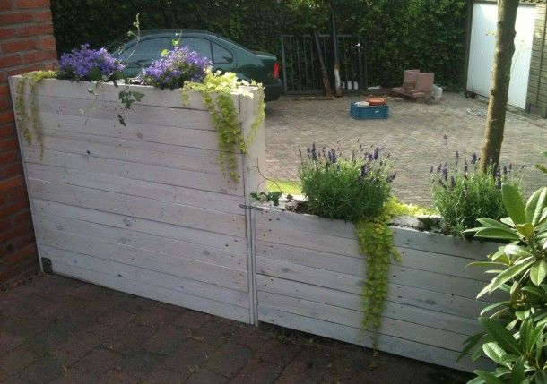 Narrow planter made of pallet wood. Then stained with whitewash stain
