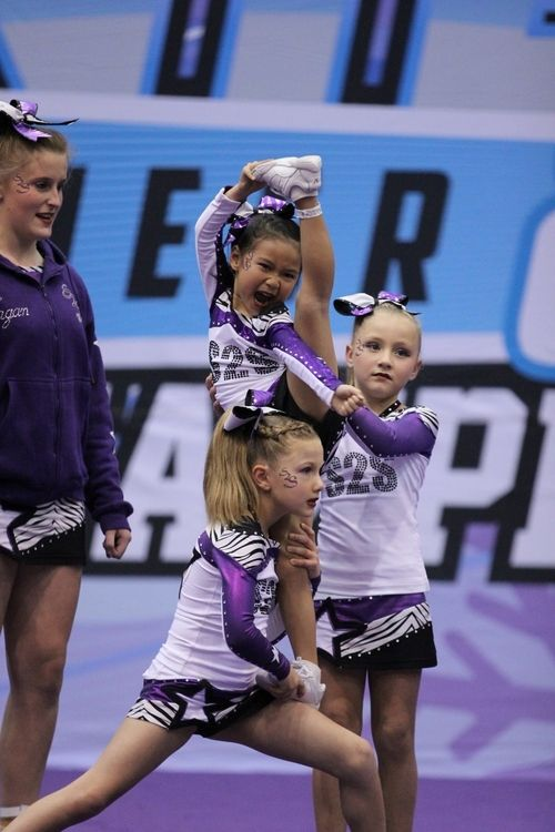 Courtney (Top age 6) With team mates Macy (Back age 10) and Perry (Lunging age 9) and junior coach Jadelyn (Tall one age 15)