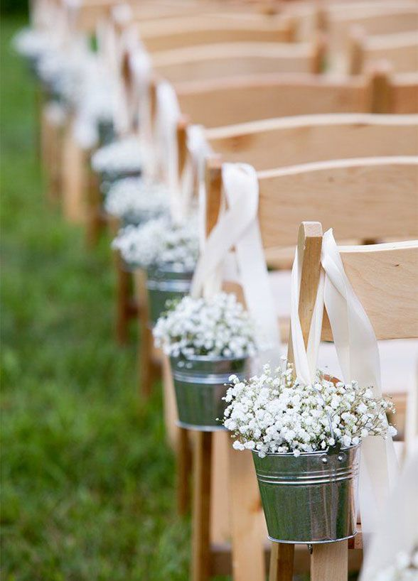Ceremony Aisle: Dress up your ceremony by lining the aisle with charming baby's breath.