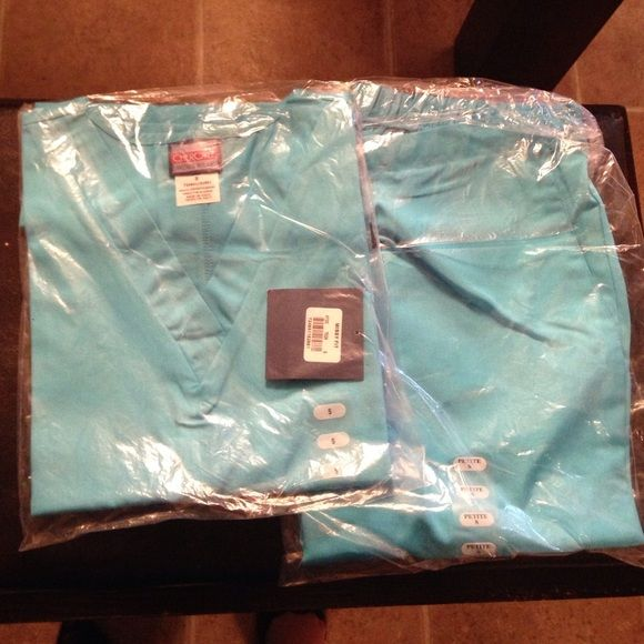 Brand new Cherokee scrub set Brand new with tags Cherokee brand scrubs! Size small. Aqua blue in color. Cherokee Other