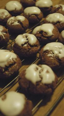 I don't remember what these are called, but chocolate Italian cookies with icing.  They're almost gingerbread-y.