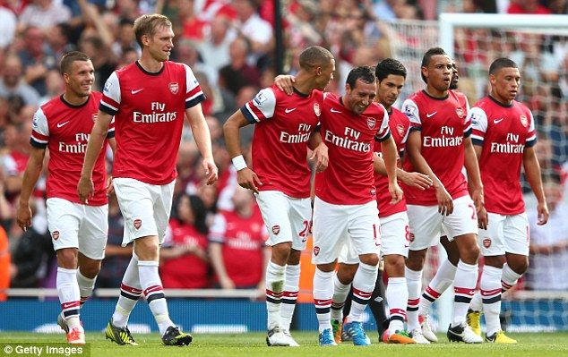 Rampant: Arsenal extended their unbeaten start to the season with a one-sided victory