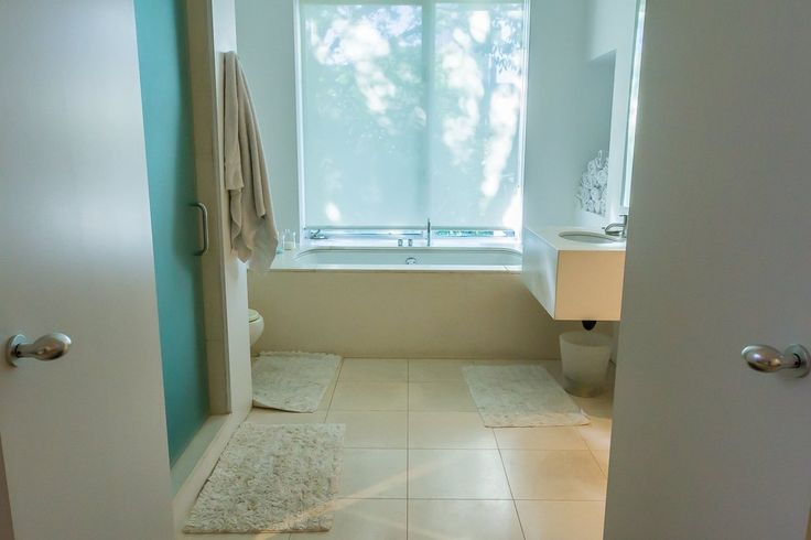 Kirsten & Chris' Timeless Style - clean layout; good nooks and hangers. Rugs/mats could be better
