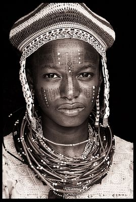 Fulani girl from Benin, Africa. Photo by John Kenny. Shame he didn't care to record her name.