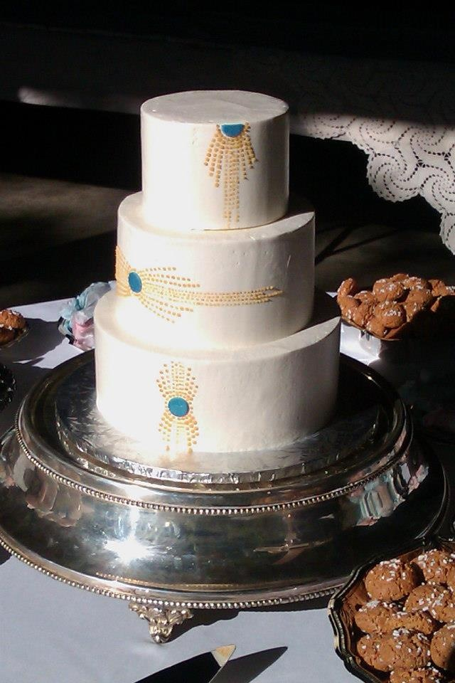 Art Deco inspired tiered wedding cake with teal and gold highlights.