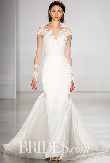 """Brides.com: . """"Evie"""" silk charmeuse fit to flare gown with tulle skirt. Hand applique Alencon lace bodice with sheer long sleeves, Kenneth Pool"""