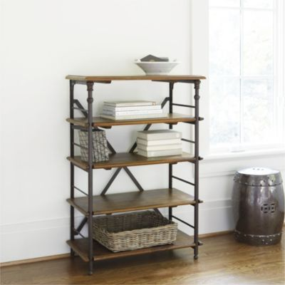 This ingeniously designed Bookcase epitomizes the best in French Industrial styling. Iron posts have decorative castings and hidden notches in the back, so you can adjust the shelves and book guards to fit the height of your books. Assembly required. Toulouse Bookcase features:Three adjustable shelvesSolid mango wood shelvesRiveted metal corner brackets & X back supports strengthen the period designAntique Walnut stain finish