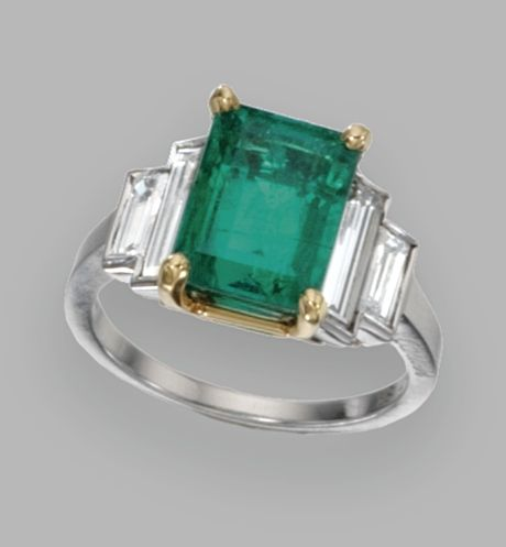 PLATINUM, 18 KARAT GOLD, EMERALD AND DIAMOND RING, CARTIER The emerald-cut emerald weighing 4.03 carats, flanked by baguette diamonds weighing 1.12 carats, size 6, signed Cartier, numbered 70145. With signed box.