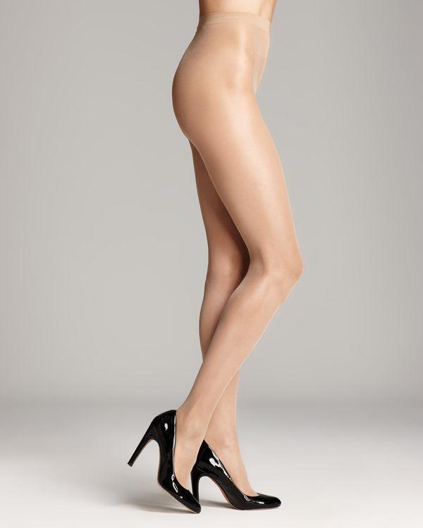 Wolford's soft sheer tights with a slight sheen let your legs shine. Style #018378 | Nylon/elastane | Elastic waistband | Nylon/elastane/cotton. Machine wash. Imported. | Web ID:559486