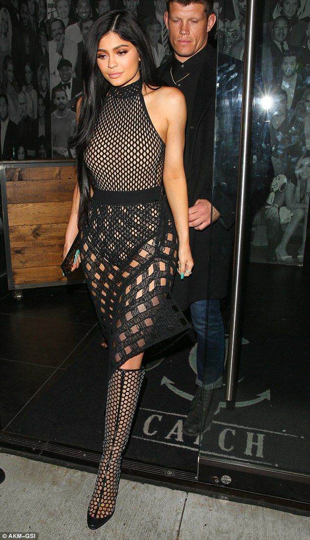 What a catch: Kylie Jenner was back to her old style tricks as she stepped out in a figure-flaunting ensemble dining at Los Angeles' eatery Catch on Saturday night
