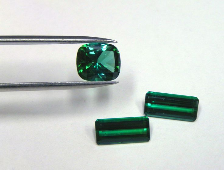 Cushion cut green Tourmaline showing fine dichroism and matching pair of emerald cut green Tourmalines. New in stock and ready to be set. #Gemstones #Tourmaline #Green #Jewellery