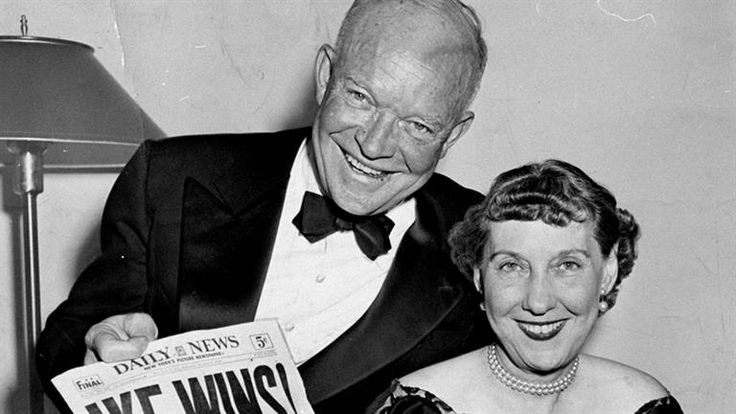 Dwight D. Eisenhower and his wife, Mamie, hold up the front page of a newspaper in 1952 announcing his presidential election victory.