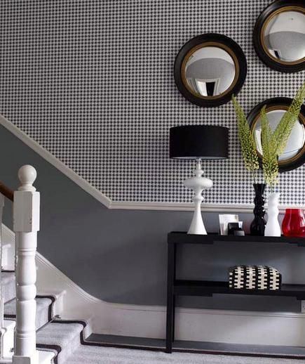 Houndstooth wallpaper makes for a handsome entryway.