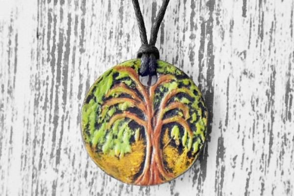 Live Love Art  Hand Painted Elm Tree Pendants    This design was modelled after a beautiful lone Elm tree that stands on the side of the TransCanada Highway between Winnipeg and Brandon. I etched the tree onto a piece of plaster, making a press mold. The pendant is crafted from porcelain clay, kiln-fired, then hand painted with acrylics.