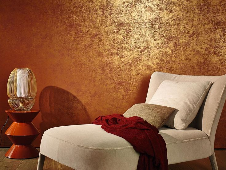 This luxurious deep red wallpaper is meant to look like plaster of Paris, but with a golden sheen on top
