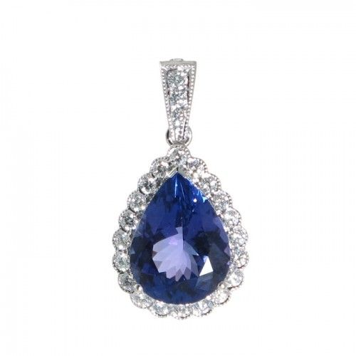 An 18ct white gold pendant featuring a faceted 6.30ct pear cut tanzanite set in three claws raised slightly above the scallop-edged cluster of round brilliant cut diamonds of estimated colour F-G clarity VS-SI all grain set within a millegrain edge the pendant is suspended in articulated form beneath a tapered enhancer diamond set bail. #Rutherford #Melbourne