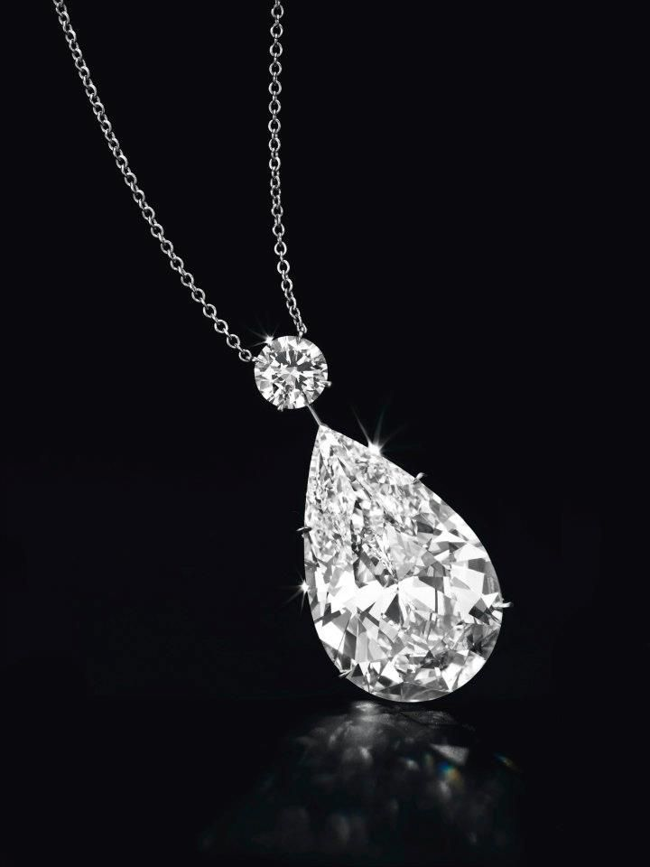 A Diamond Pendant Necklace Weighing Approximately 50.52 Carats. Christie's image Ltd 2012    Suspending a pear-shaped diamond, weighing approximately 50.52 carats, from a circular-cut diamond, weighing approximately 2.28 carats, to the fine link neckchain, mounted in platinum, 17½ ins.