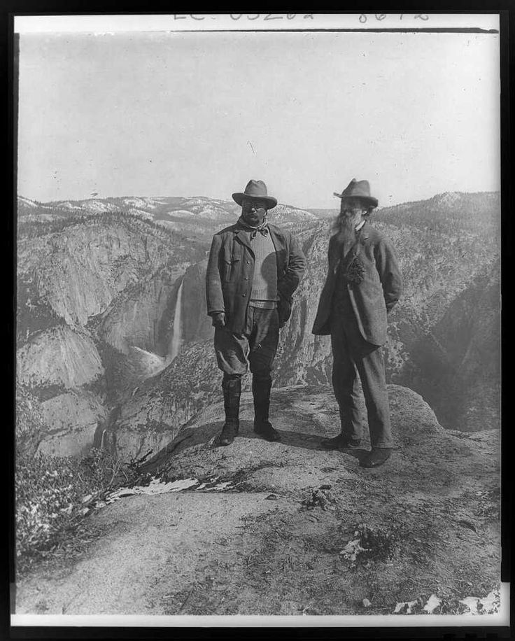 """Theodore Roosevelt and John Muir stand on Glacier Point. """"Bully!"""""""