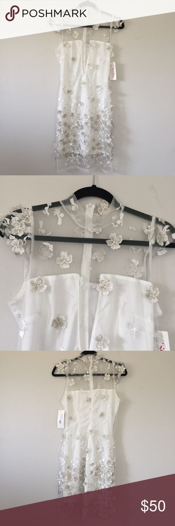 """3D Flower Dress Brand new with tags High neck and plunge  Not sure if this runs a little small so please refer to measurements below.  Approx measurements: Armpit to armpit: 17""""  Length: 37.5"""" Dresses Mini"""