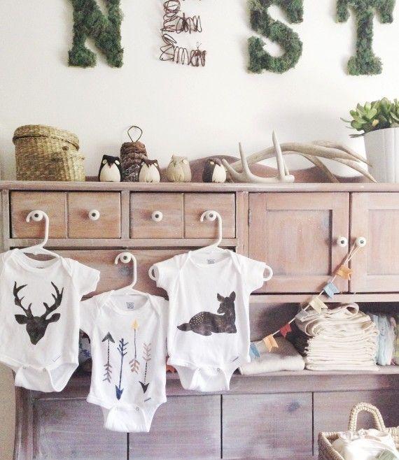 Stencilled wilderness onesies DIY Baby Onesies for Your Little ones