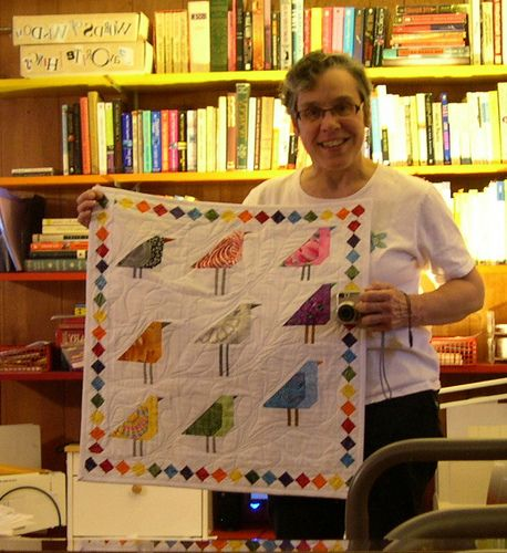 Here I am with my finished quilt for DQS9.  It's become kind of a tradition for me to take a picture of myself holding my finished Doll Quilt. (in the mirror. this is a lot harder than it looks!)