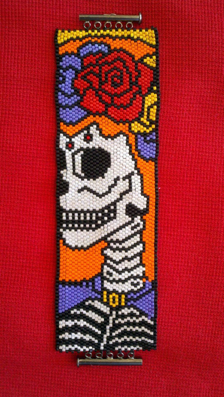 Beadweaving by Bev Berthoty. Peyote stitch.  Delicas. Sugar Skull pattern by Debbie van Tonder.Day of the Dead.
