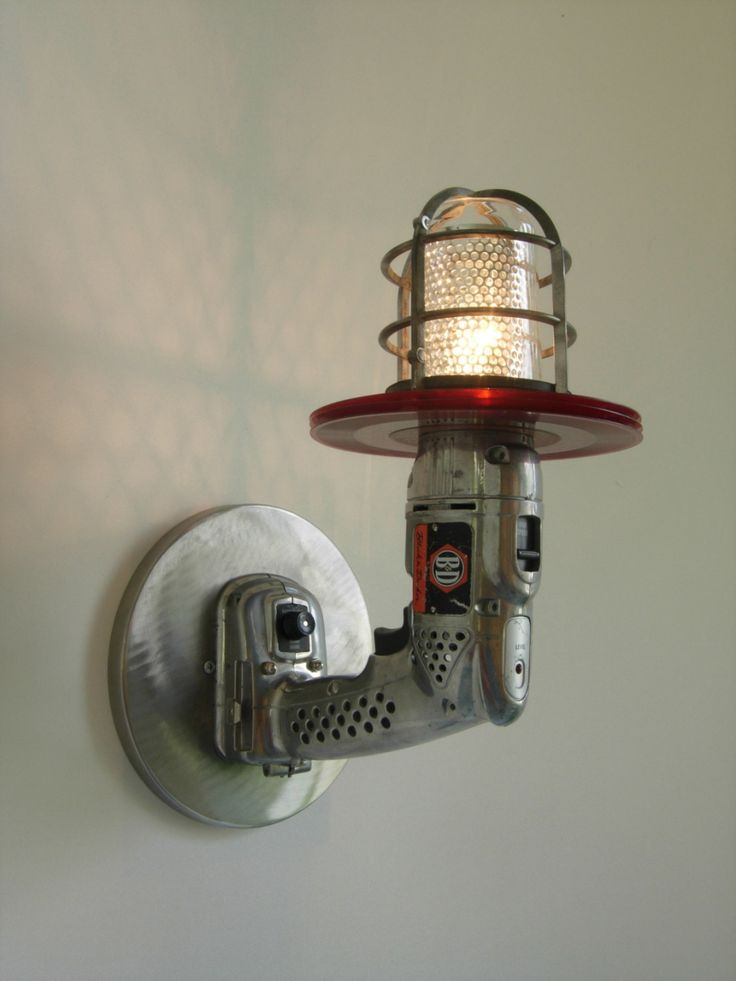 Sci Fi industrial light sconce made with an old cordless drill (and other things).