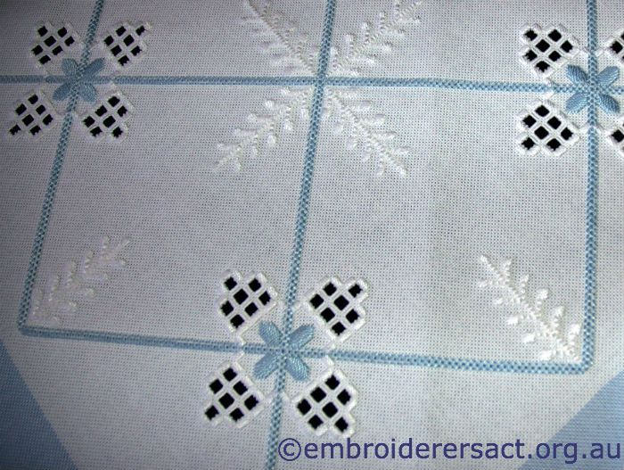 Photo on guild website. Love it! Blue & white Hardanger tablecloth