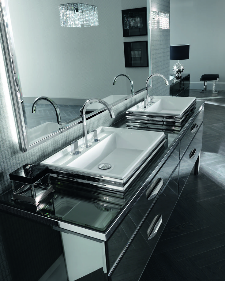 The reflection of luxury. Dual Venezia faucets and refined crystal handles add striking elegance to this MITAGE bathroom.