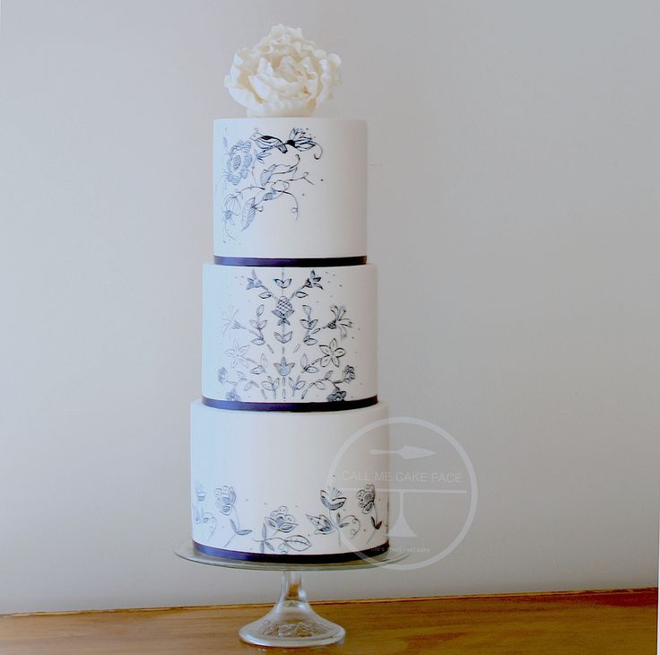 Hand painted in blue and adorned with a large sugar peony.