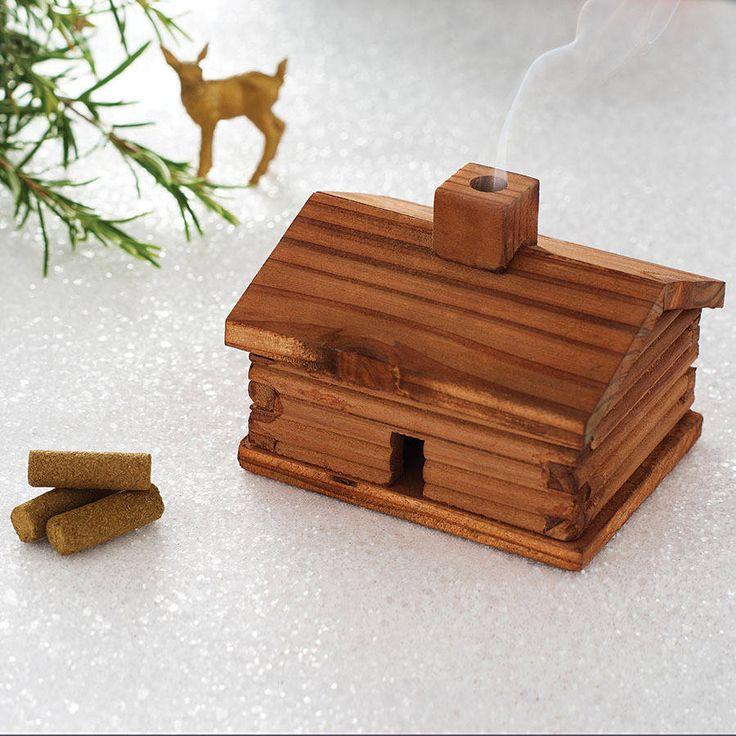 Smoking Wooden Log Cabin