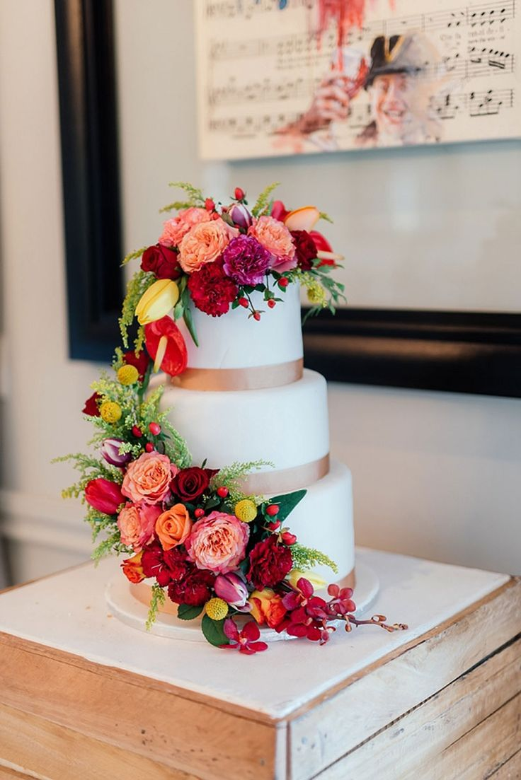 White wedding cake, bright flowers