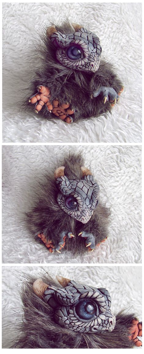 http://steinntr0ll.deviantart.com/art/Dragon-Cub-387283267