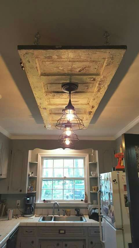 Old door on the ceiling with two hanging lights. Great idea!