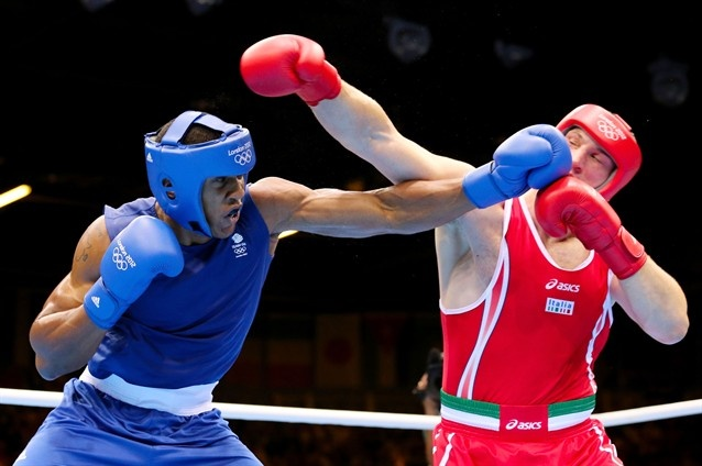 Anthony Joshua (L) of Great Britain exchanges punches with Roberto Cammarelle (R) of Italy during the Men's Super Heavy (+91kg) Boxing final bout.