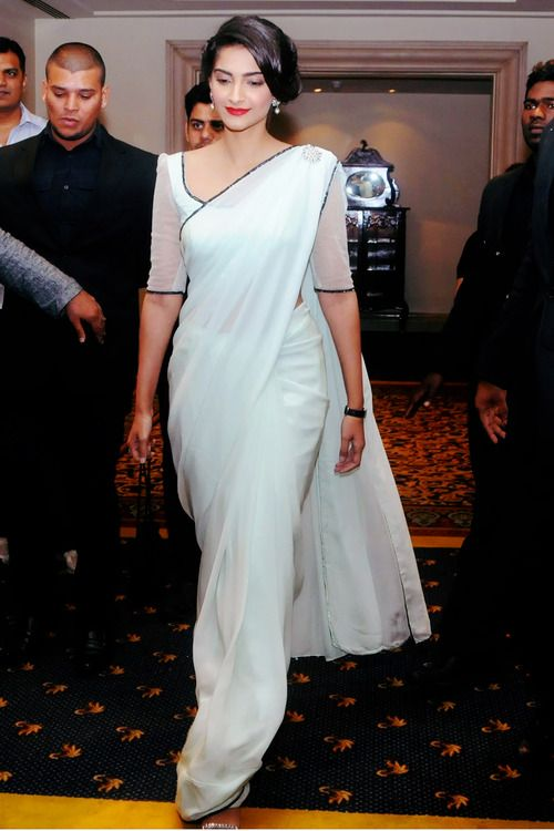 Pure and simple. White saree.