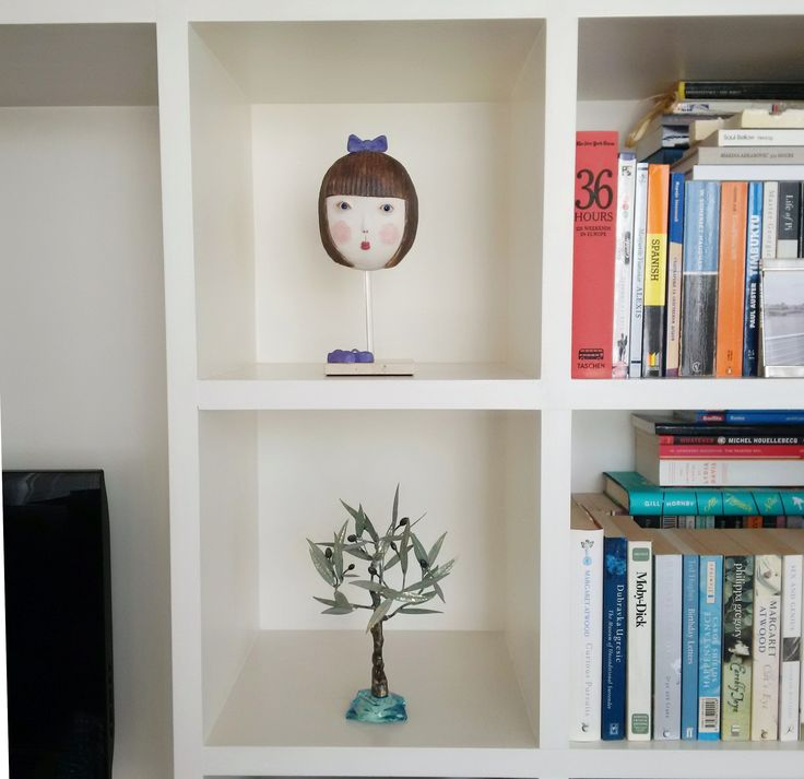 Girl with blue shoes is now in a lovely lady's home.