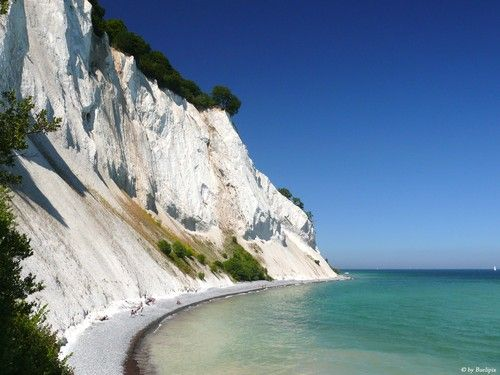 See the white chalk cliffs of Mons Klint, Denmark.