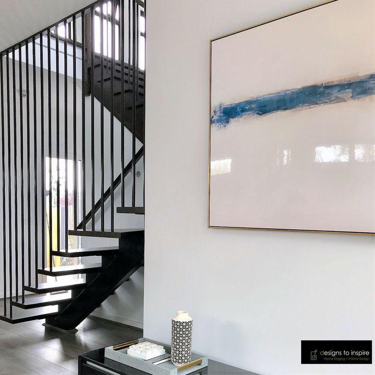 Pairing abstract artwork near a sculptural staircase. How do you like it?  #designstoinspire #styling