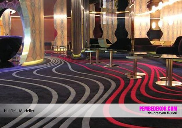 Burada kırmızı ve siyah renk tonlarında bir halı modeli sergilenmektedir. Bu modeller dar ve küçük odalar için uygun olmayabilir. Oldukça büyük alanlarda ise klasik ve avangard modellerle