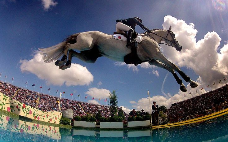 Penelope Leprevost of France rides  'Mylord Carthago' during the London 2012 Olympic Games Equestrian Jumping competition