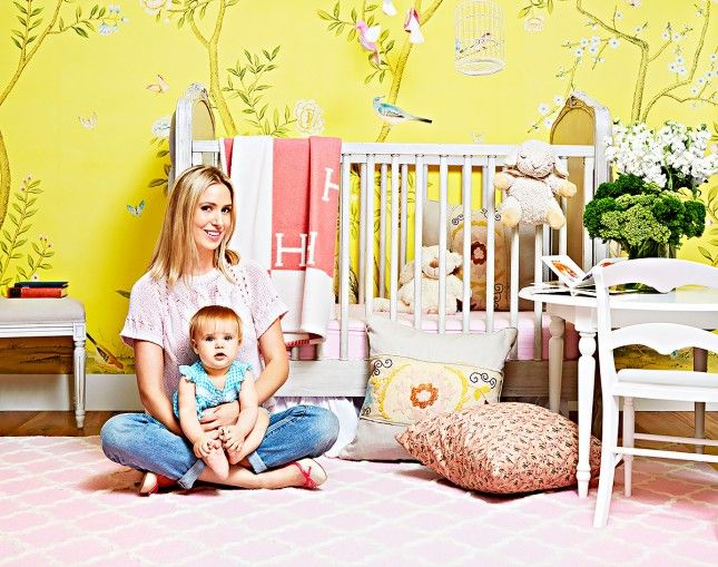 Deck out your nursery with a bright patterned wallpaper.